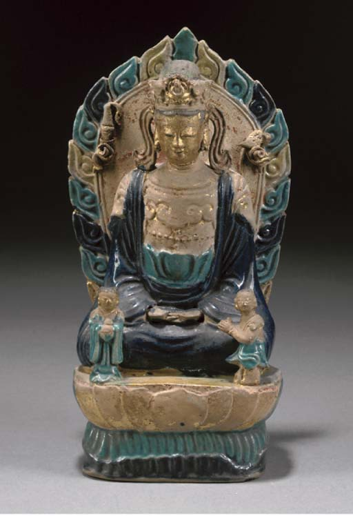 A CHINESE BLUE AND TURQUOISE-GLAZED BISCUIT FIGURE OF GUANYIN, WANLI