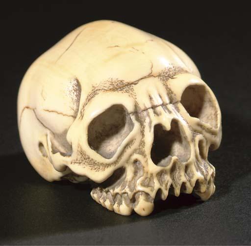 An Ivory netsuke of a human sk