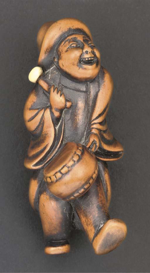 A wood and ivory netsuke of a