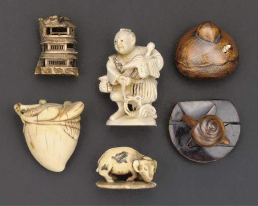 An ivory netsuke carved as a f