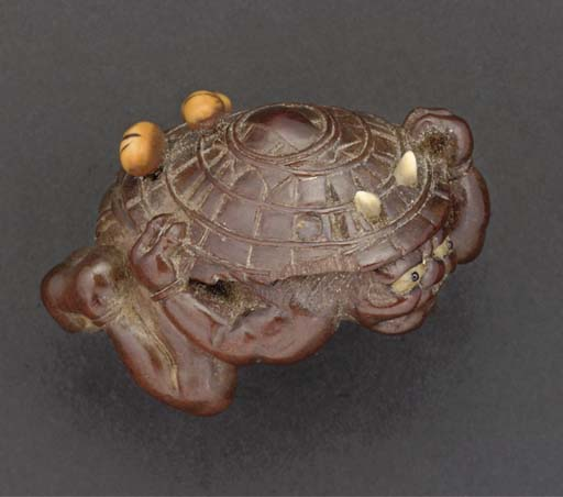 An ivory inset wood netsuke of