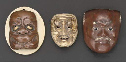 A lacquered wooden mask netsuk