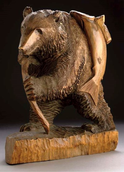 A large carved wooden bear, 20