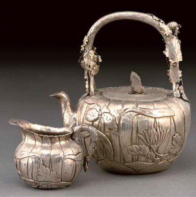 A silver teapot and jug, late