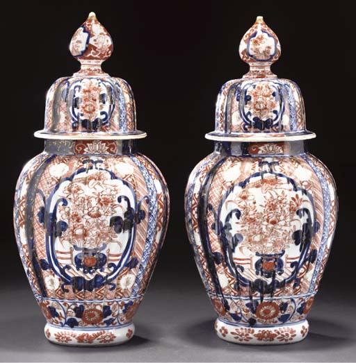 A pair of fluted Imari jars an