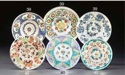 THREE KUTAHYA POTTERY PLATES,