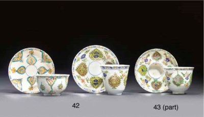 TWO KUTAHYA CUPS AND SAUCERS,
