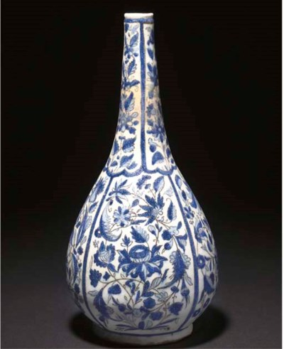 A QAJAR BLUE AND WHITE BOTTLE