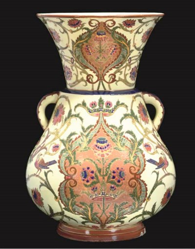 A CONTINENTAL VASE IN THE FORM
