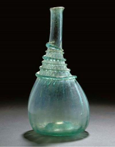 A PALE GREEN IRIDESCENT GLASS