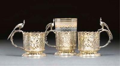 THREE PIERCED SILVER TEA GLASS