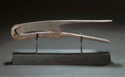 A LARGE IRON BETEL NUT CUTTER,
