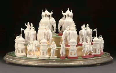 A COMPLETE IVORY CHESS SET, IN