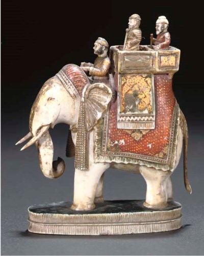 A PAINTED AND GILT IVORY MODEL