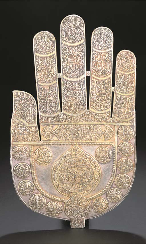 A LARGE SILVER-GILT HAND OF FA
