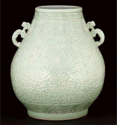 A Chinese carved celadon hu va