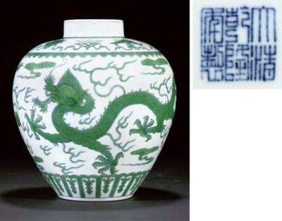 A green enamelled dragon jar,