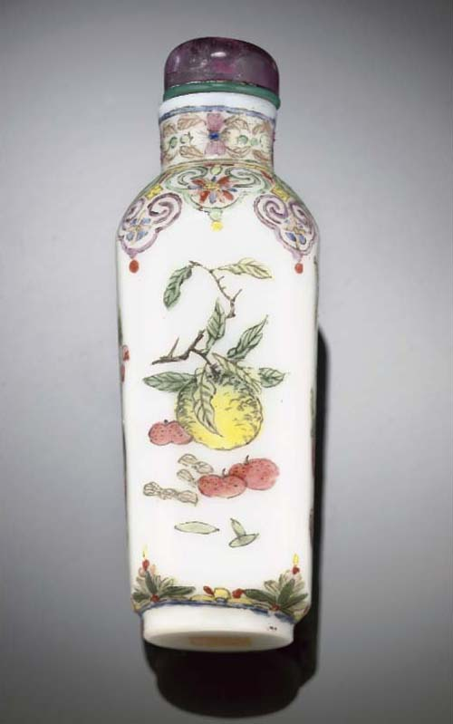 A famille rose enamelled white glass snuff bottle, iron red Qianlong seal mark and possibly of the period