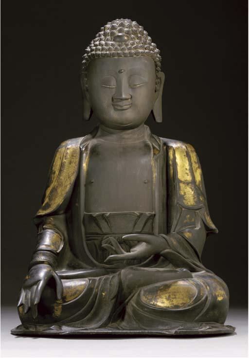 A large gilt-bronze model of Buddha, 16th/17th Century