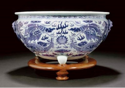 A blue and white tripod censer