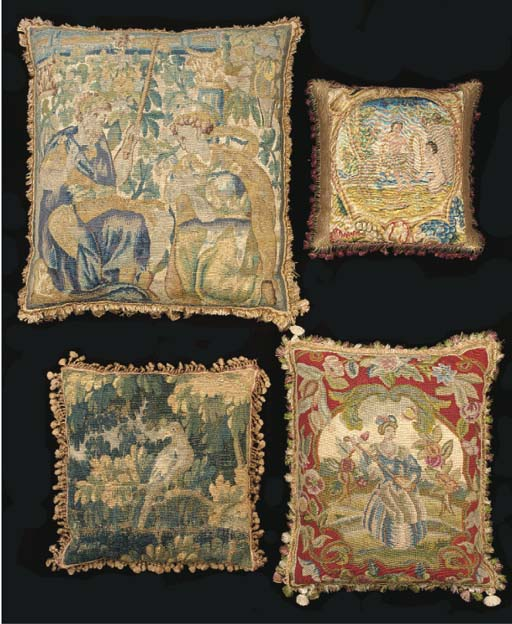 A collection of cushions inclu