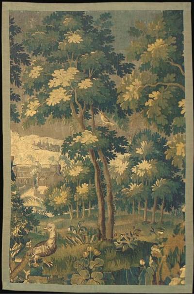 A Flemish verdure tapestry pan