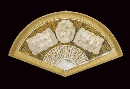 A rare trompe l'oeil fan with a map of Northern Italy, the chicken skin leaf painted with an oval map of the Veneto, Milan, Parma, Genoa, etc. and Corsica within a trompe l'oeil lace frame, and two rectangular drawings of figures playing boules and others playing cards, also framed in trompe l'oeil lace, against a simulated tortoiseshell ground, the ivory sticks carved and pierced with flowers and painted with Chinese figures--11in., the leaf Italian circa 1760
