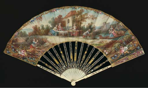 Le dejeuner en plein air, a fan, the leaf painted with elegant figures lunching by a fountain by a river with a lady arriving by punt and a chateau beyond, a woman delivering melons, the verso with a landscape with a lady arranging a net for bird-catching, the ivory sticks carved, pierced, silvered and gilt with figures--10in. circa 1770