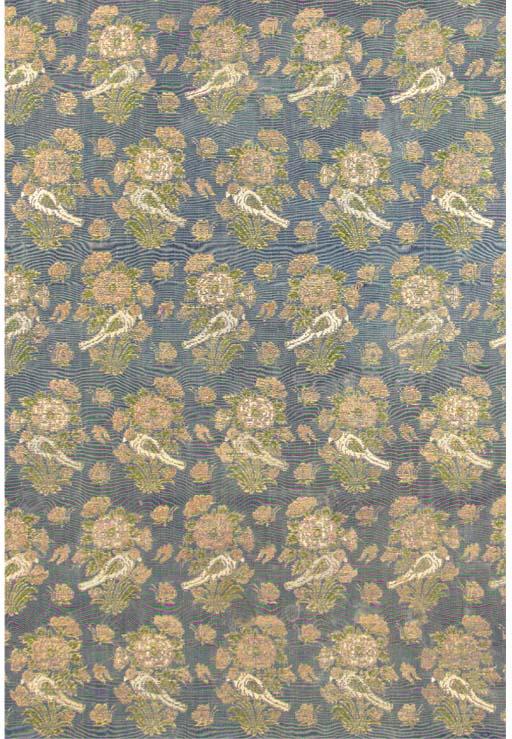 A panel of blue silk brocade,