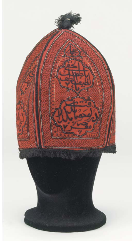 An embroidered conical hat of
