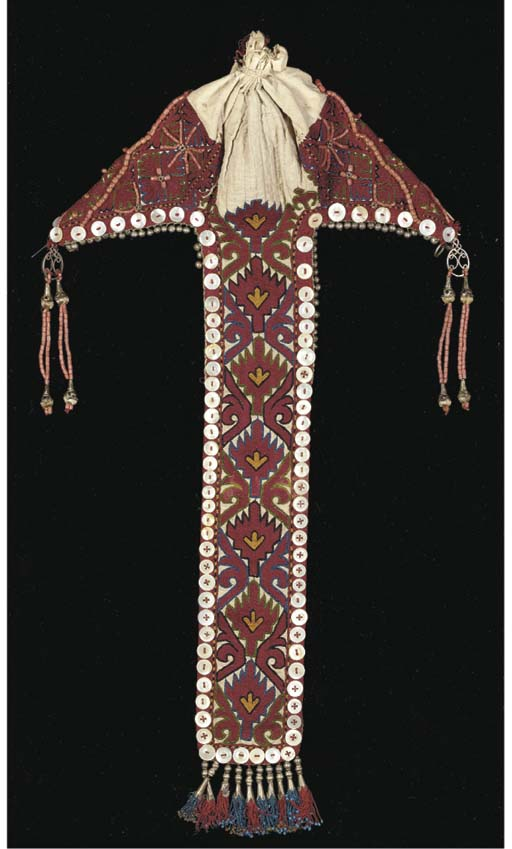 A lady's hat, the cotton embroidered with magenta stylised flowers, with plait cover trimmed with buttons and beaded fringes and coral beads, late 19th century, Kirgiz