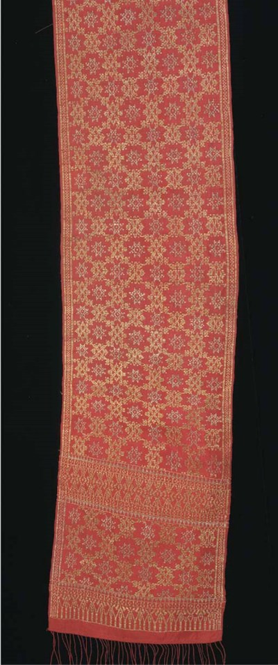 A sarong of brocaded silk, the