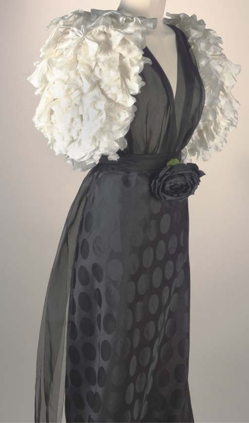 AN EVENING GOWN BY GIVENCHY