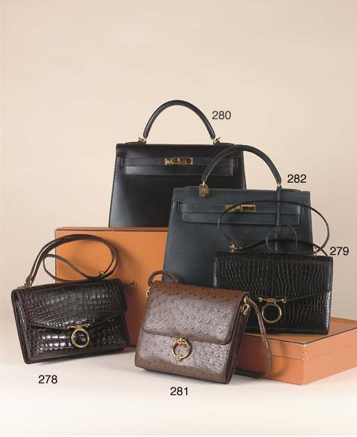 A BLACK LEATHER KELLY BAG BY H