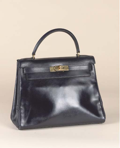 A KELLY BAG OF NAVY BLUE LEATHER BY HERMÉS