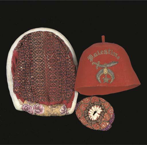 A DOMED RED FELT 'FEZ' CAP