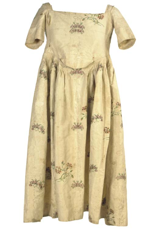 A YOUNG GIRL'S DRESS OF IVORY