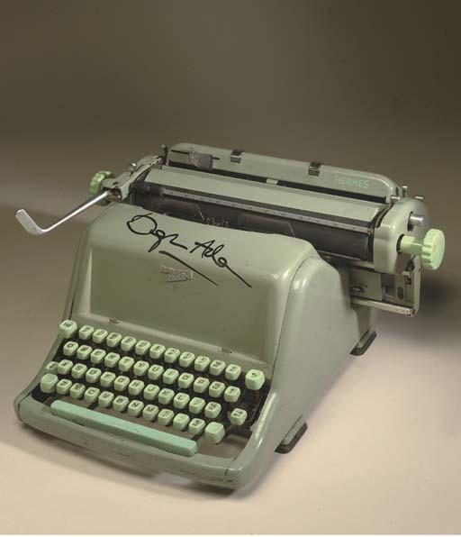 ADAMS, Douglas (1952-2001). Hermes Standard 8 Manual Typewriter, grey-green enamel casing, SIGNED IN THICK FELT PEN BY ADAMS ACROSS THE FRONT CASING.