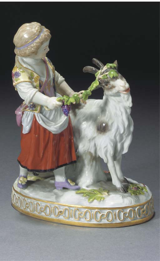 A Meissen figure of a girl with goat