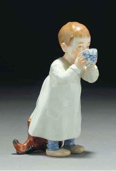 A Meissen figure of a boy drin