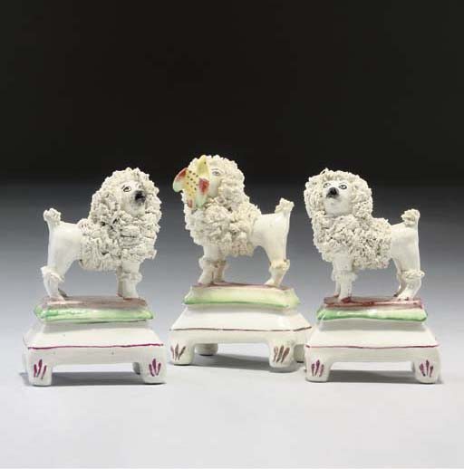 A COLLECTION OF STAFFORDSHIRE AND CONTINENTAL POTTERY AND PORCELLANEOUS MODELS OF POODLES