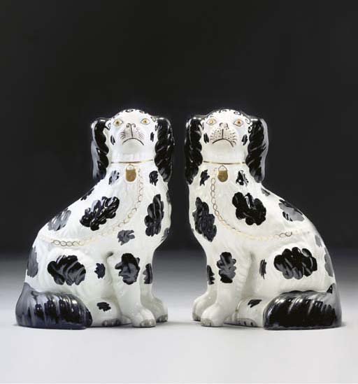 A PAIR OF STAFFORDSHIRE POTTERY MODELS OF SPANIELS