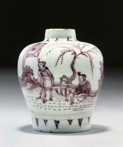A SMALL DELFT BALUSTER VASE