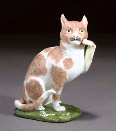 A MEISSEN MODEL OF A SEATED CA