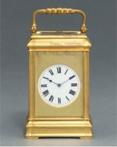A Swiss gilt-brass hour-striki