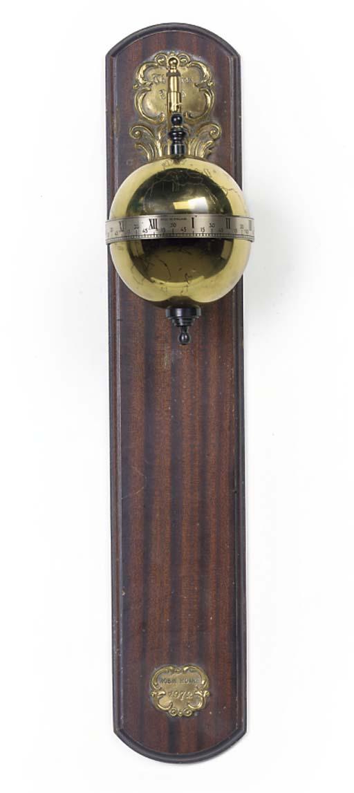 An English brass and mahogany