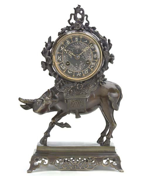 A French small bronze striking mantel clock, circa 1880
