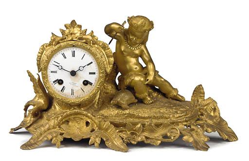 A French gilt-metal striking m