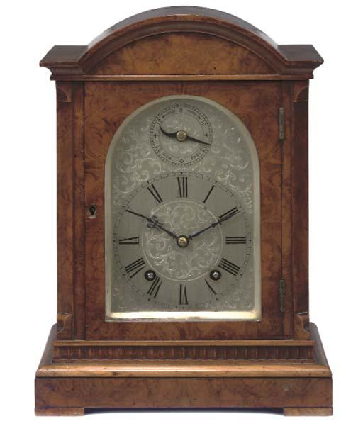 A German burr-walnut striking mantel clock, late 19th Century
