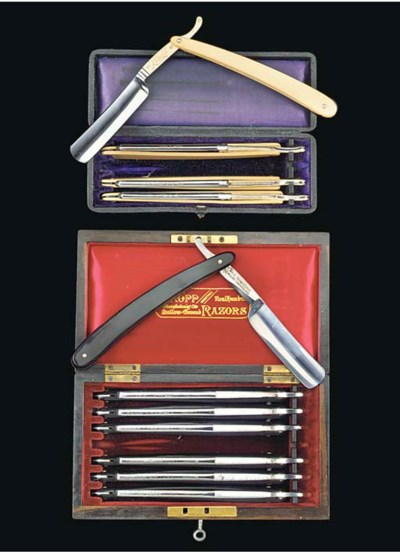 Two cased razor sets,